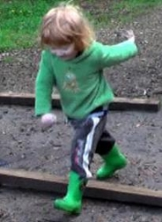 Toddler stepping over obstacle_1.jpg