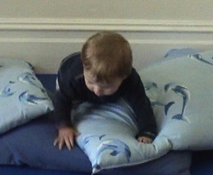 W 9m crawling over pillows 5.jpg