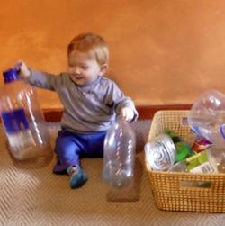 T  14 months playing with plastic bottles.jpg